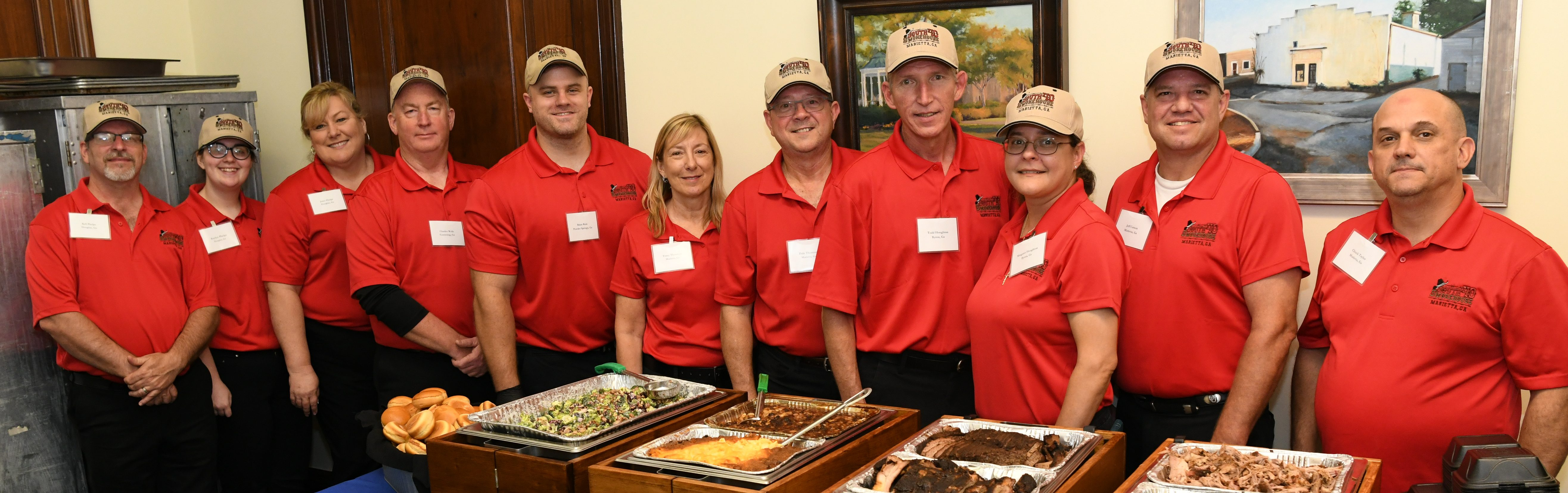 The serving line set up in Senator Isakson's office with the entire Smokehouse 40 BBQ catering team. (Left to Right) Kell Phelps, Raylyn Phelps, Janet Phelps, Charles Wells, Brian Rule, Tracey Thornton, Dale Thornton, Todd Houghton, Margaret Houghton, Jeff Carson, and Chuck Taylor.
