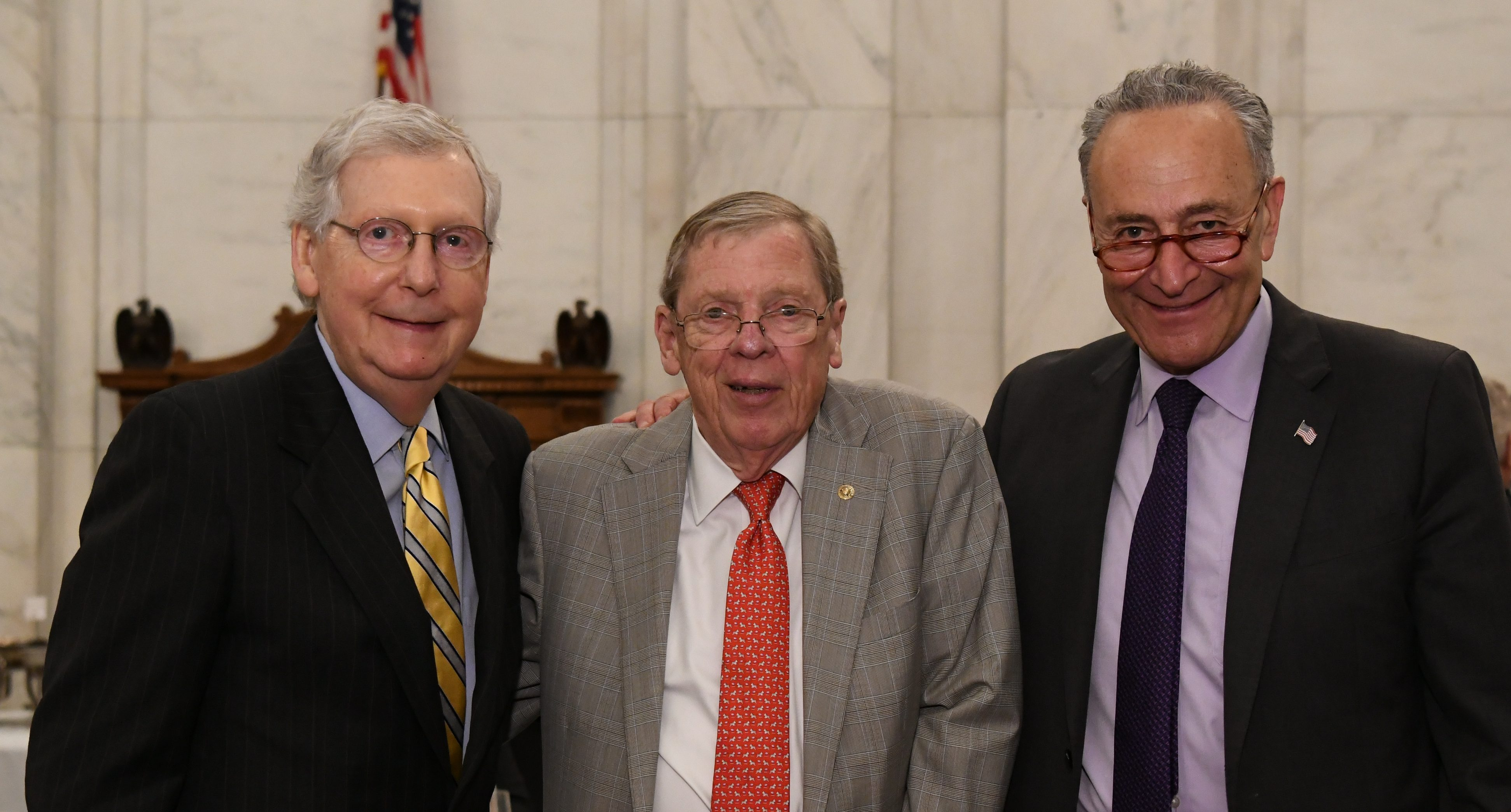 This photo sums up the meaning of this entire article as we see both Senate leaders Chuck Schumer (right) and Mitch McConnell (left) stop for a photo with Georgia Senator Johnny Isakson (center) during the only bi-partisan lunch the U.S. Senate will have this year.